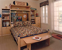 Football fan's bedroom design by Montanna & Associates as featured in Kid Space Ideabook.