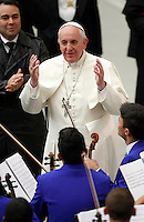 Papa Francesco saluta i ragazzi di un'orchestra durante l'udienza ai membri della Catholic Fraternity of Charismatic Covenant Communities and Fellowships, nell'Aula Paolo VI, Citta' del Vaticano, 31 ottobre 2014.<br /> Pope Francis greets members of a youth orchestra during an audience with members of the Catholic Fraternity of Charismatic Covenant Communities and Fellowships, in the Paul VI hall at the Vatican, 31 October 2014.<br /> UPDATE IMAGES PRESS/Isabella Bonotto<br /> <br /> STRICTLY ONLY FOR EDITORIAL USE