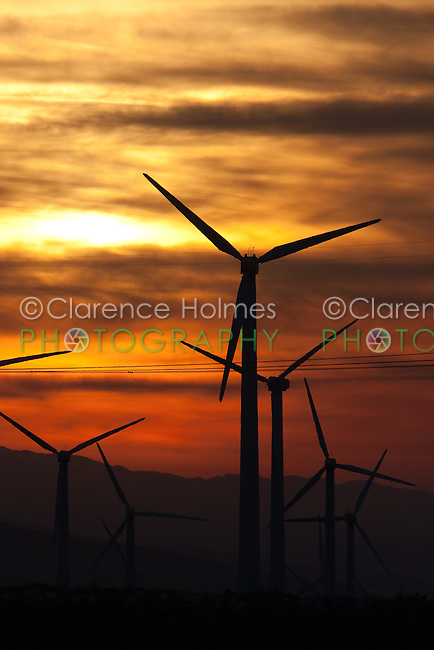 Wind turbines, silhouetted against the sunrise colored sky, generating electricity on the San Gorgonio Pass Wind Farm serving Palm Springs, California