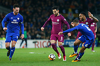 Ilkay Gundogan of Manchester City is challenged by Sean Morrison and Jazz Richards of Cardiff City during the Fly Emirates FA Cup Fourth Round match between Cardiff City and Manchester City at the Cardiff City Stadium, Wales, UK. Sunday 28 January 2018