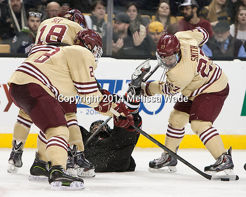 Michael Sit (BC - 18), Scott Savage (BC - 28), Braden Pimm (NU - 14), Quinn Smith (BC - 27) - The Boston College Eagles defeated the Northeastern University Huskies 4-1 (EN) on Monday, February 10, 2014, in the 2014 Beanpot Championship game at TD Garden in Boston, Massachusetts.