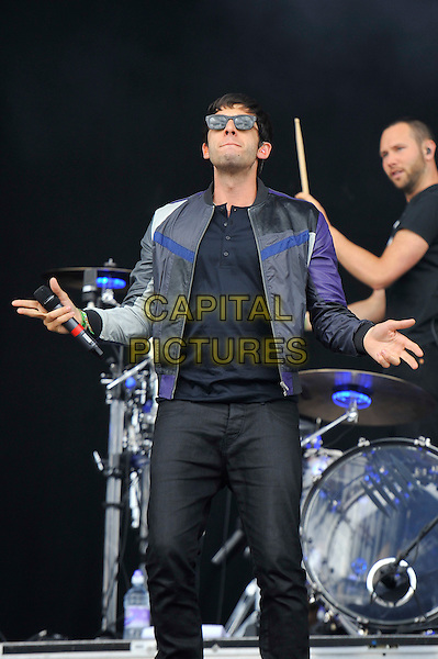 Example (Elliot John Gleave).performing at the Barclaycard Wireless Festival, Hyde Park, London, England. 7th July 2012..music live gig on stage show half length sunglasses black leather grey gray bomber jacket sunglasses trousers t-shirt microphone hands 3/4 .CAP/MAR.© Martin Harris/Capital Pictures.