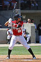 Kristopher Negron #11 of the Carolina Mudcats hitting during a game against the Montgomery Biscuits on April 18, 2010 in Zebulon, NC.