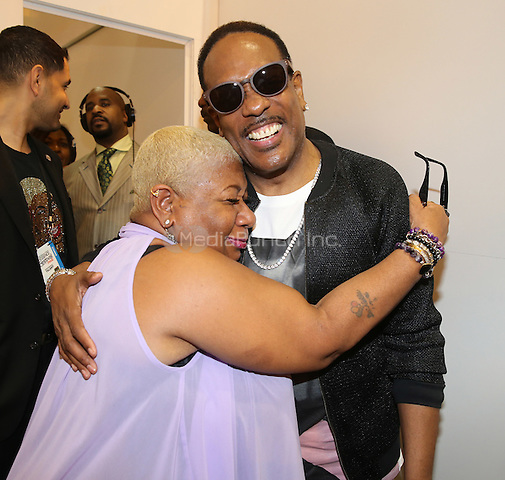 NEW ORLEANS, LA - JULY 4: Luenell and Charlie Wilson at the Ford Motor Company booth at the 2015 Essence Festival at Ernest N. Morial Convention Center on July 4, 2015 in New Orleans, Louisiana. Credit: mpiPG/MediaPunch