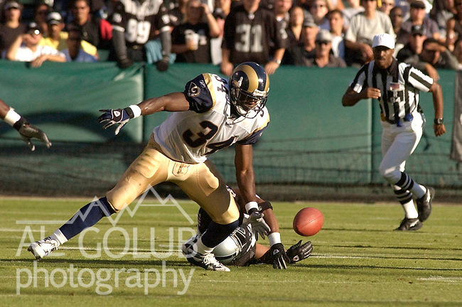 St. Louis Rams running back Lamar Gordon (34) goes after loose ball on Friday, August 8, 2003, in Oakland, California. The Raiders defeated the Rams 7-6 in a preseason game.