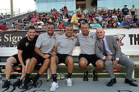 Cary, North Carolina  - Saturday August 05, 2017: Paul Riley (right) with his staff (from right) Scott Vallow, Sean Nahas, Nathan Thackeray, and Matty Golden prior to a regular season National Women's Soccer League (NWSL) match between the North Carolina Courage and the Seattle Reign FC at Sahlen's Stadium at WakeMed Soccer Park. The Courage won the game 1-0.