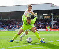 Scunthorpe United's Jak Alnwick shields the ball from Peterborough United's Matthew Godden<br /> <br /> Photographer Chris Vaughan/CameraSport<br /> <br /> The EFL Sky Bet League One - Scunthorpe United v Peterborough United - Saturday 13th October 2018 - Glanford Park - Scunthorpe<br /> <br /> World Copyright &copy; 2018 CameraSport. All rights reserved. 43 Linden Ave. Countesthorpe. Leicester. England. LE8 5PG - Tel: +44 (0) 116 277 4147 - admin@camerasport.com - www.camerasport.com