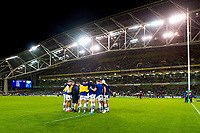 The Bath Rugby forwards huddle together during the pre-match warm-up. Heineken Champions Cup match, between Leinster Rugby and Bath Rugby on December 15, 2018 at the Aviva Stadium in Dublin, Republic of Ireland. Photo by: Patrick Khachfe / Onside Images