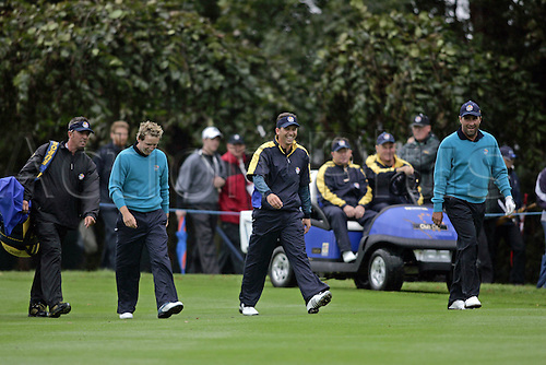 20 September 2006: European players Luke Donald, Sergio Garcia and Jose Maria Olazabal share a joke on the 10th fairway during practice for The 2006 Ryder Cup played at The K Club, Straffan, County Kildare, Ireland. Photo: Glyn Kirk/Actionplus....060920 golf golfer