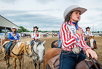 Miss Rodeo Colorado 2016 contestants from left, Kelsie Winslow, Mandi Larson, Alex Hyland and  Sara Coblentz during the national anthem at the Miss Rodeo Queen Colorado competition at the Greely Stampede in Greely, Colorado, July 1, 2015.<br /> <br /> Photo by Matt Nager