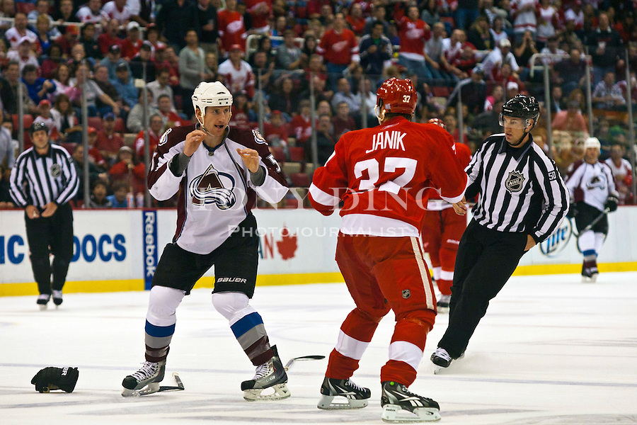 12 October 2010: Colorado Avalanche forward Cody McLeod, left, and Detroit Red Wings defenseman Doug Janik (37) drop their gloves to fight in the first period of the Colorado Avalanche at Detroit Red Wings NHL hockey game, at Joe Louis Arena, in Detroit, MI...***** Editorial Use Only *****