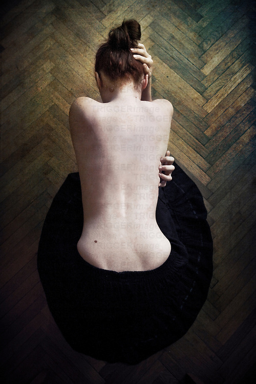 A young woman semi naked with a bare back