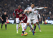 4th February 2019, London Stadium, London, England; EPL Premier League football, West Ham United versus Liverpool; Aaron Cresswell of West Ham United  challenges the shot from Virgil van Dijk of Liverpool