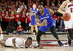 VERMILLION, SD - JANUARY 24: Tevin King #2 from South Dakota State University picks up the loose ball past Triston Simpson #3 from the University of South Dakota during their game Wednesday night at the Sanford Coyote Sports Center in Vermillion, SD. (Photo by Dave Eggen/Inertia)