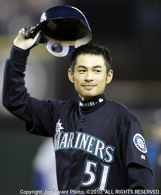 Seattle Mariners Ichiro Suzuki tips his hat to the fans after hitting a ball into center field which broke George Sisler's 1920 single season record of 257 in the third inning on Friday, Oct. 1, 2004 against the Texas Rangers at Safeco Field in Seattle.  Suzuki raised his single season hitting  total to 259.  Jim Bryant Photo. ©2010. ALL RIGHTS RESERVED.