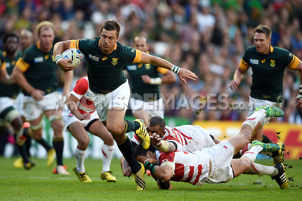 Handre Pollard of South Africa gets past Michael Leitch and Harumichi Tatekawa of Japan. Rugby World Cup Pool B match between South Africa and Japan on September 19, 2015 at the Brighton Community Stadium in Brighton, England. Photo by: Patrick Khachfe / Onside Images