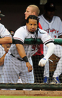 Jun. 23, 2009; Albuquerque, NM, USA; Albuquerque Isotopes outfielder Manny Ramirez reacts in the dugout against the Nashville Sounds at Isotopes Stadium. Ramirez is playing in the minor leagues while suspended for violating major league baseballs drug policy. Mandatory Credit: Mark J. Rebilas-