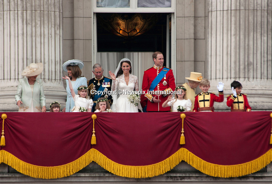 """Prince William and Catherine Middleton wave to the crowds gathered below the Buckingham Palace Balcony, joined by other members of the Royal family and Wedding Party.London_29/04/2011.Mandatory Photo Credit: ©Dias/Newspix International..**ALL FEES PAYABLE TO: """"NEWSPIX INTERNATIONAL""""**..PHOTO CREDIT MANDATORY!!: NEWSPIX INTERNATIONAL(Failure to credit will incur a surcharge of 100% of reproduction fees)..IMMEDIATE CONFIRMATION OF USAGE REQUIRED:.Newspix International, 31 Chinnery Hill, Bishop's Stortford, ENGLAND CM23 3PS.Tel:+441279 324672  ; Fax: +441279656877.Mobile:  0777568 1153.e-mail: info@newspixinternational.co.uk"""