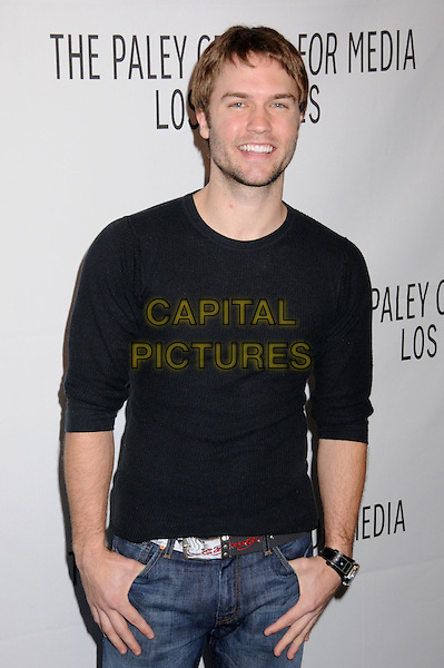 """SCOTT PORTER.The 25th Annual Paley TV Festival Presents """"Friday Night Lights"""" at Arclight Cinemas, Hollywood, California, USA..March 19th, 2008.half length stubble facial hair black top .CAP/ADM/BP.©Byron Purvis/AdMedia/Capital Pictures."""