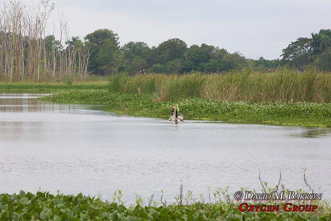 Man Fishing From Raft