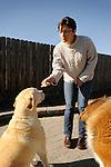 Matisse Weigle feeding dog reward biscuit.