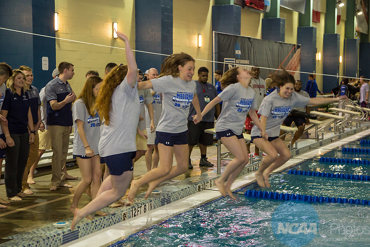 BIRMINGHAM, AL - MARCH 11: Queens University swimmers and divers celebrate after their Men's and Women's first place team victories by jumping in the pool with their clothes on during the Division II Men's and Women's Swimming & Diving Championship held at the Birmingham CrossPlex on March 11, 2017 in Birmingham, Alabama. The Men's team scored a combined total of 563.5 points and the Women compiled 467 points. (Photo by Matt Marriott/NCAA Photos via Getty Images)