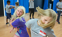 NWA Democrat-Gazette/BEN GOFF @NWABENGOFF<br /> Emma Nelson (left), 9, of Bentonville and Violet Strickland, 9, of Farmington learn stage combat techniques Tuesday, June 11, 2019, during the Shakespeare Camp at Trike Theatre in Bentonville. The five-day camp is one of many offered by Trike Theatre over the summer. Trike Theatre is also presenting the Northwest Arkansas Shakespeare Festival this week with performances of 'A Midsummer Night's Dream' at 7:00 p.m. Thursday, Friday and Saturday at Train Station Park across from the Bentonville Public Library.