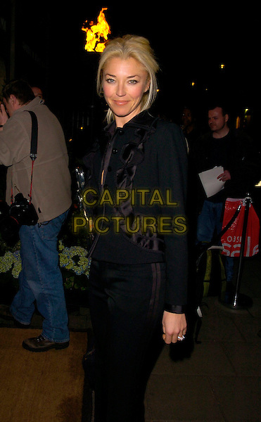 TAMARA BECKWITH.Lavender Trust Party, Claridge's Hotel, London, UK..March 14th, 2007.half length black jacket ruffles purse.CAP/CAN.©Can Nguyen/Capital Pictures