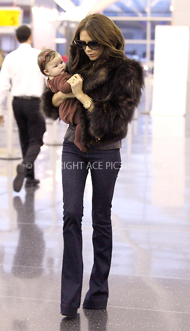 WWW.ACEPIXS.COM . . . . .  ....November 16 2011, New York City....Victoria Beckham carries her daughter Harper through JFK Airport to catch a flight to LAX on November 16 2011 in New York City....Please byline: John Peters - ACE PICTURES.... *** ***..Ace Pictures, Inc:  ..Philip Vaughan (212) 243-8787 or (646) 679 0430..e-mail: info@acepixs.com..web: http://www.acepixs.com