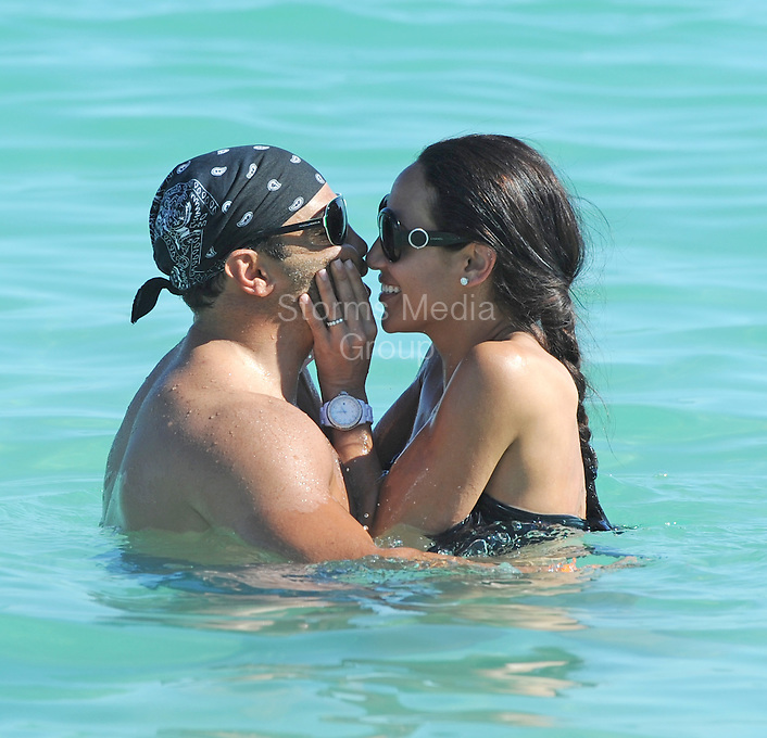SMG_FLXX_Melissa Gorga_Joe Gorga_Bikini_NYE_123111_01.JPG<br /> <br /> MIAMI BEACH, FL - DECEMBER 31: &quot;Real Housewives of New Jersey's&quot; Melissa Gorga (sporting a sexy black two piece bikini) and her husband Joe share a kiss while playing in the water in South Beach.  on December 31, 2011 in Miami Beach, Florida  (Photo By Storms Media Group)  <br /> <br /> People:  Melissa Gorga_Joe Gorga<br /> <br /> Transmission Ref:  FLXX<br /> <br /> Must call if interested<br /> Michael Storms<br /> Storms Media Group Inc.<br /> 305-632-3400 - Cell<br /> 305-513-5783 - Fax<br /> MikeStorm@aol.com