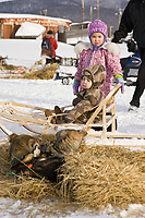 Youngsters Jamie & Calvin McGinty of Kaltag watch Aaron Burmeisters dogs rest & get fed in Kaltag on Sunday morning during Iditarod 2008