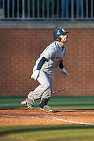 Hunter Kopycinski (4) of the Rice Owls follows through on his swing against the Charlotte 49ers at Hayes Stadium on March 6, 2015 in Charlotte, North Carolina.  The Owls defeated the 49ers 4-2.  (Brian Westerholt/Four Seam Images)