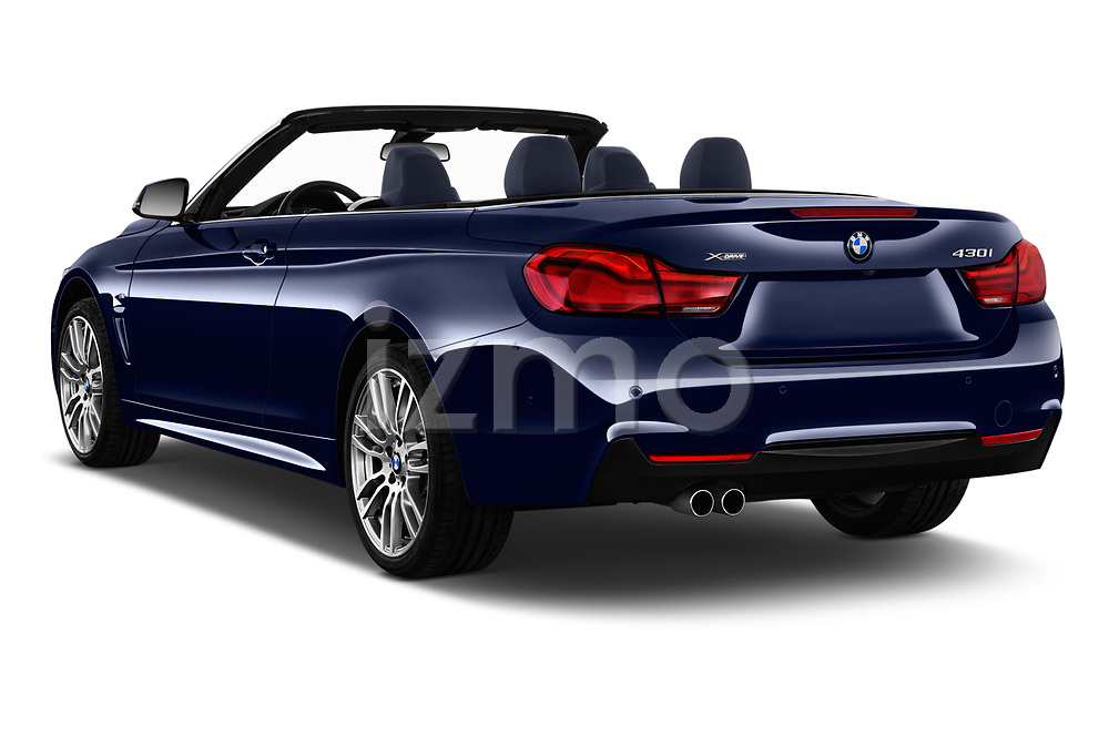 Car pictures of rear three quarter view of a 2018 BMW 4 Series M Sport 2 Door Convertible angular rear