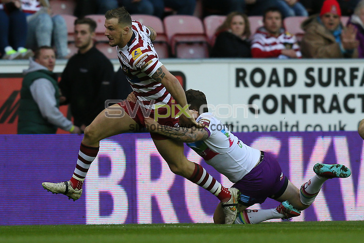 Picture by Paul Currie/SWpix.com - 01/05/2015 - Rugby League - First Utility Super League - Wigan Warriors v Hull Kingston Rovers- DW Stadium, Wigan, England - Wigan Warriors Dom Manfredi is tackled by Hull Kr's Ben Cockayne