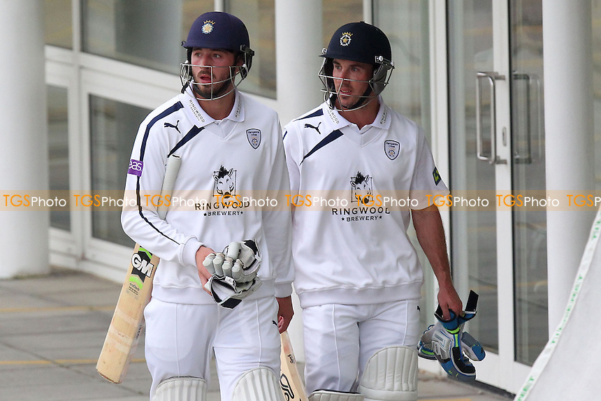 Hampshire batsmen James Vince (L) and Tom Smith look on as bad light stops play on Day One - Hampshire CCC vs Essex CCC - LV County Championship Division Two Cricket at the Ageas Bowl, West End, Southampton - 16/06/14 - MANDATORY CREDIT: Gavin Ellis/TGSPHOTO - Self billing applies where appropriate - 0845 094 6026 - contact@tgsphoto.co.uk - NO UNPAID USE