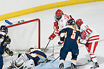 MADISON, WI - SEPTEMBER 29: Jinelle Zaugg #8 of the Wisconsin Badgers women's hockey scores a goal against the Quinnipiac Bobcats at the Kohl Center on September 29, 2006 in Madison, Wisconsin. The Badgers beat the Bobcats 3-0. (Photo by David Stluka)