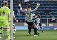 Max Kretzschmar of Wycombe Wanderers attempts to control the ball in a goalmouth scramble during the Sky Bet League 2 match between Wycombe Wanderers and Hartlepool United at Adams Park, High Wycombe, England on 5 September 2015. Photo by Andy Rowland.