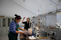 "China - Ningxia - Zhang Jing, 41, co-founder and winemaker at Helan Qingxue Vineyard, in the laboratory, tasting the latest grape juices harvested. The winery's success has come at a significant personal price for Zhang, the mother of a 9-year-old child. ""It is not easy to combine work and motherhood"", she explains. ""At harvest time I have to live in the winery for four consecutive weeks and I struggle to see my daughter""."