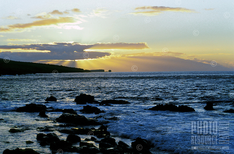 Lanai coastline looking towards Maui, with Puupehe Island (Sweetheart Rock) in the background