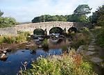 Historic Packhorse bridge at Postbridge, Dartmoor national park, Devon, England crossing the East Dart river