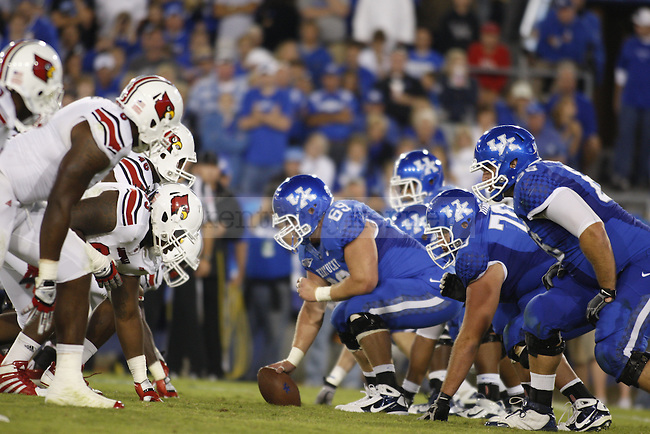 the UK offensive line squares up against the Louisville defensive live during UK's home game against Louisville, Saturday, Sept. 17, 2011 in Lexington, Ky.  Photo by Brandon Goodwin | Staff