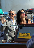 George Clooney & Amal Alamuddin arriving in Venice with guests, prior to their wedding - Italy