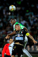 MEDELLIN - COLOMBIA -30-11-2014: Juan Valencia (Der.) jugador de Atletico Nacional disputa el balón con Harrison Henao (Izq.) jugador de Once Caldas durante partido entre Atletico Nacional y Once Caldas por fecha 4 de los cuadrangulares semifinales de la de la Liga Postobon II 2014, jugado en el estadio Atanasio Girardot de la ciudad de Medellin. / Juan Valencia (R), player of Atletico Nacional fights for the ball with Harrison Henao (L) player of Once Caldas during a match for the between Atletico Nacional and Envigado FC for the fourth date of the quadrangular semifinals of the Liga Postobon II 2014 at the Atanasio Girardot stadium in Medellin city. Photo: VizzorImage. / Luis Rios / Str.