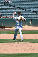 Kaleb Cowart (31) of the Salt Lake Bees throws to first base on defense against the Fresno Grizzlies in Pacific Coast League action at Smith's Ballpark on June 14, 2015 in Salt Lake City, Utah.  (Stephen Smith/Four Seam Images)