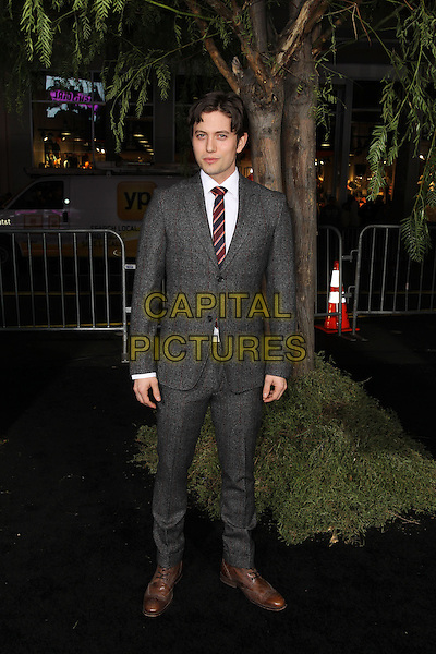 "Jackson Rathbone.""Beautiful Creatures"" Los Angeles Premiere held at the TCL Chinese Theatre, Hollywood, California, USA. .February 6th, 2013.full length suit grey gray red stripe tie blue.CAP/CEL .©CelPh/Capital Pictures."