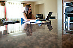 University of California, Merced student Katilyn McIntire studies in the spacious rental home  she shares in Merced, Calif., October 29, 2011.