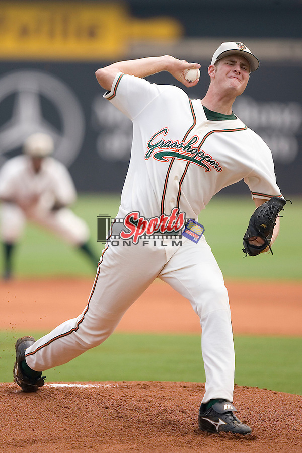 Greensboro Grasshoppers starting pitcher Chris Volstad winds up to deliver the ball to the plate versus the Charleston RiverDogs at First Horizon Park in Greensboro, NC, Wednesday, August 9, 2006.