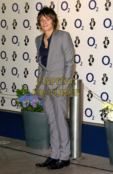 PAULO NUTINI.Attending the Nordoff-Robins 02 Silver Clef Luncheon, Hilton Park Lane Hotel, London, England,.June 29th 2007..full length grey suit.CAP/CAN.©Can Nguyen/Capital Pictures