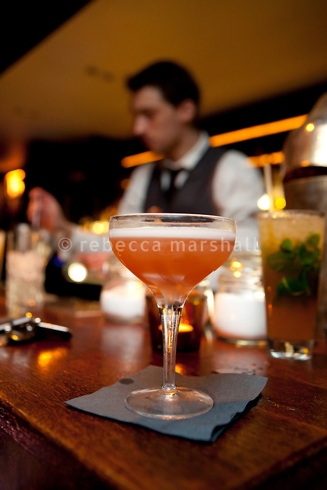 Slumdog Millionaire cocktail (foreground) served at Soda cocktail bar, Lyon, France, 13 January 2012