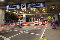 Car streaks at the passenger drop off level in the Austin–Bergstrom International Airport (ABIA) - Stock Image.